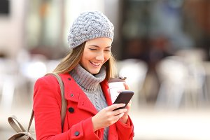 woman using mobile phone in winter