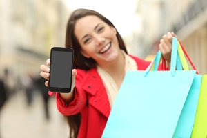 Shopper shopping and showing phone