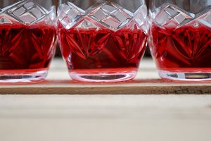 three glasses of red liquor