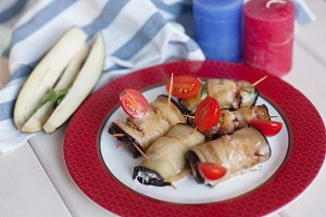 Eggplant rolls with walnuts, chicken and tomato