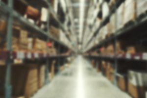 Blurry large warehouse inventory space for background