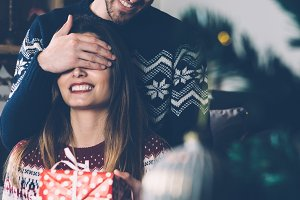 Man making surprise present for girlfriend