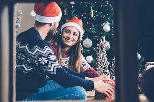 Loving couple decorating gift box