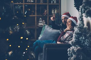 Couple on sofa looking at fir tree