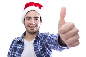 male young with hat of santa doing sign of ok