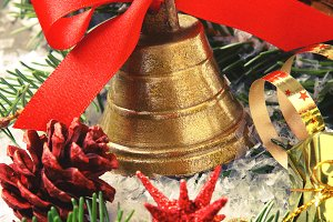 Golden bell with red ribbon bow and christmas decoration