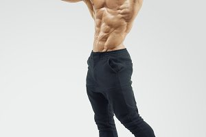 Young fitness male model posing