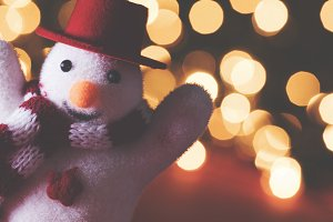 Festive snowman and fairy lights