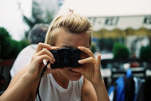 blonde girl with lomo camera