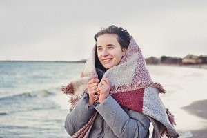 Pretty girl walking on a sea beach