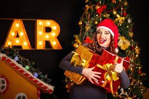 Girl and two Christmas gift