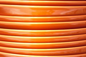 Stack of orange plates close-up