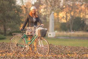 Young woman park bicycle autumn