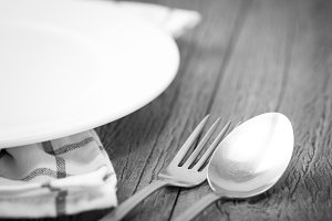 White plate and fork and spoon