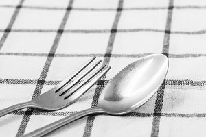 Fork and spoon on table
