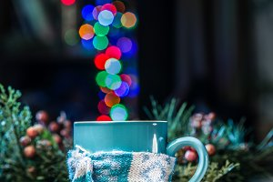 Cup with magic colorful lights.