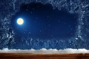 Frozen window with moon.