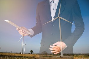 Businessman on wind turbine