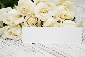 White roses with card