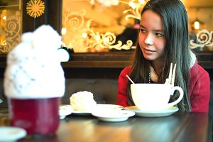 Girl in a Christmas cafe