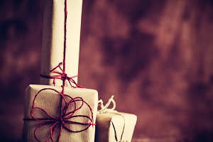 Rustic retro gifts, present boxes on wooden background. Christmas time