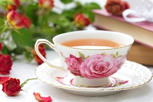 Cup of tea, books and roses