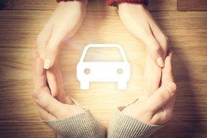 Car symbol inside hands circle. Concept of car insurance