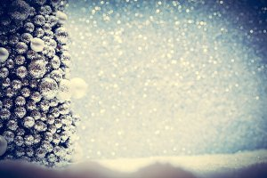 Winter Christmas decoration. Snow, glitter and Christmas tree ornament.