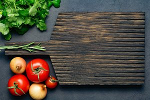 Wooden board and vegetables