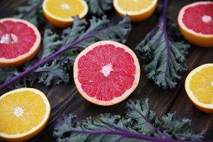 Grapefruit, Oranges and Kale on Wood
