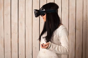Woman in virtual reality helmet.