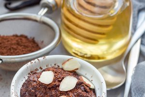 Healthy vegan homemade dessert with avocado, cocoa, vanilla, honey and almond milk, chocolate mousse, vertical