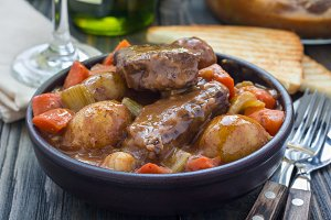 Hearty beef stew with carrot, celery, shallot and potato, horizontal