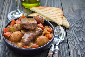 Hearty beef stew with carrot, celery, shallot and potato, horizontal, copy space