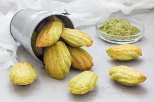 Homemade matcha green tea madeleines on the table and in metal bucket, horizontal