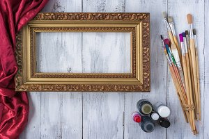 Framing frame with brushes and paint