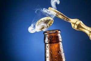 Opening of beer cap.