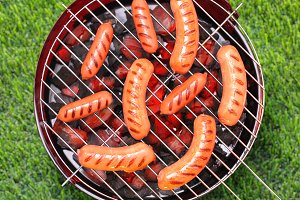 Grilling sausages on a bbq