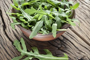 Green arugula leaves in the plate