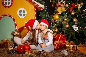 Sister kiss her sister. Christmas.