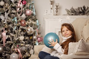 Girl and Christmas decorations.