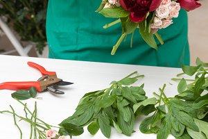 Florist making peonies bouquet