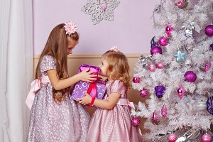 Sisters with Christmas gifts