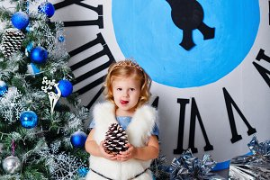 Girl holding pine cone. Christmas