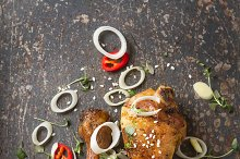 Fried chicken legs, sauce. Cooking for Christmas. Dark background.