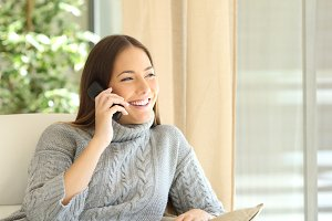Woman talking on a land line