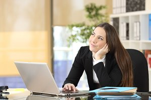 Happy pensive businesswoman