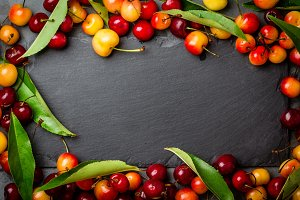 frame background. Ripe red and yellow cherry. Top view