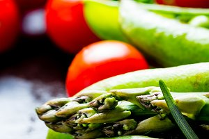 Fresh vegetables - asparagus, tomatoes, rosemary, green pea, bell pepper
