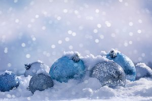 Christmas balls on the fluffy snow.